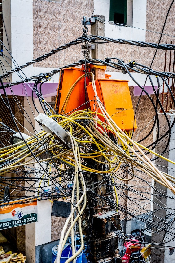 Bunch of entangled cables on the street